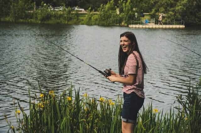 Happy teenager while fishing