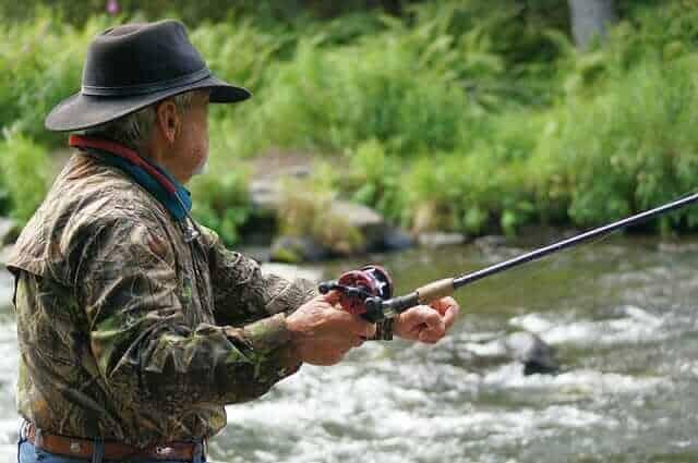 Fisherman fishing with baitcaster