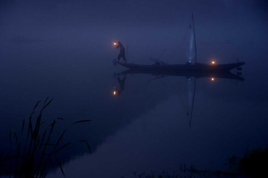 Why do fishermen fish at night