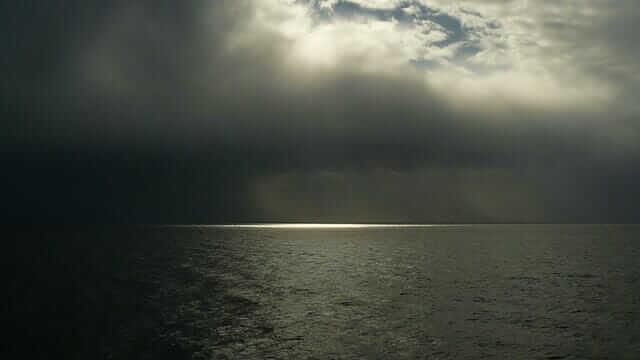 Cloudy sea while bass fishing