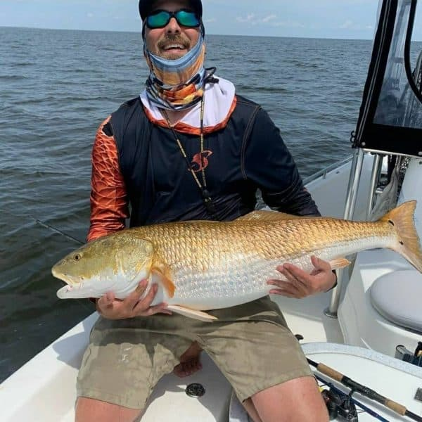 The joy of catching red drum on a fishermans face