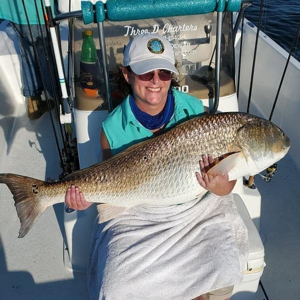 Happy angler with redfish